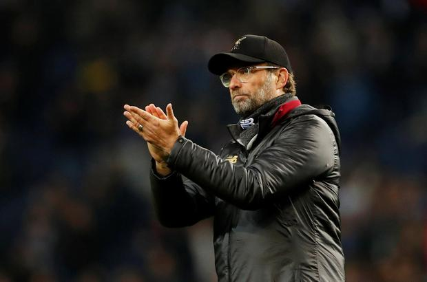 Liverpool manager Jurgen Klopp applauds a job well done in Porto. Photo: Action Images via Reuters/Andrew Boyers