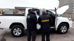 Search: Gardaí and members of the CAB examine a vehicle during the raids in Cork