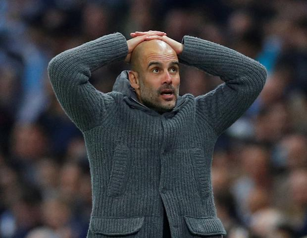 Manchester City manager Pep Guardiola reacts after Raheem Sterling's late goal was ruled out for offside. REUTERS/Phil Noble