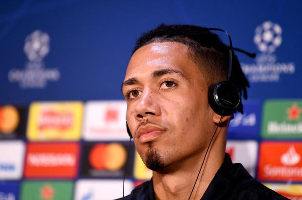 Chris Smalling of Manchester United speaks to the media during the Manchester United Press Conference ahead of the UEFA Champions League Quarter Final First Leg match between Manchester United v FC Barcelona at Old Trafford (Photo by Nathan Stirk/Getty Images)