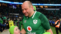 Rory Best celebrates Ireland's Six Nations Grand Slam success in Twickenham last year with his children Ben and Penny. Photo: Ramsey Cardy/Sportsfile
