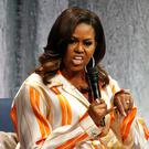 Former first lady Michelle Obama speaks at the AccorHotels Arena during a book tour to promote her memoir