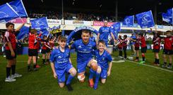 Match-day mascots Finn Kelly and Ben Ward with Leinster captain Seán O'Brien. Photo: Sportsfile