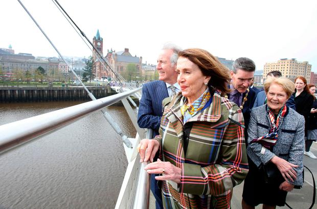Bridging the divide: Nancy Pelosi (centre) and US Congressman Richard Neal (left) on the Peace Bridge in Derry. Photo: PAUL FAITH/AFP/Getty Images