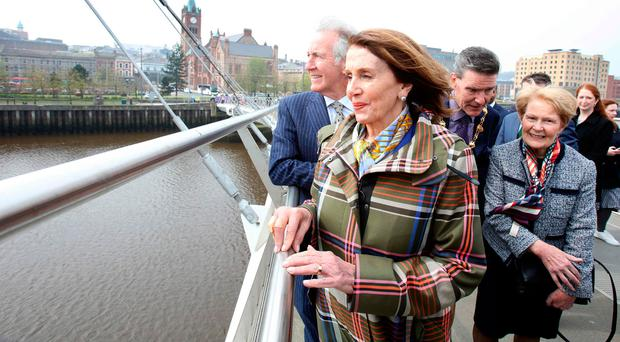 Pelosi recalls tanks and barbed wire on walk over Peace Bridge