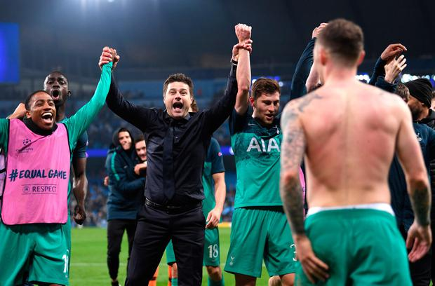 Mauricio Pochettino celebrates with his Tottenham players at the Etihad on Wednesday. Photo: Laurence Griffiths/Getty Images