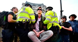 An Extinction Rebellion protester being arrested in London. Photo: Leon Neal/Getty Images