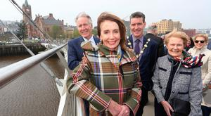 US House of Representatives speaker Nancy Pelosi (centre) with Pat Hume (centre right) on the Peace Bridge in Derry yesterday, as part of her four-day visit to Ireland and Northern Ireland. Photo: PA