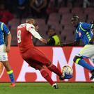 Arsenal's French striker Alexandre Lacazette (C) shoots to score a free-kick during the UEFA Europa League quarter-final second leg football match Napoli vs Arsenal on April 18, 2019 at the San Paolo stadium in Naples. (Photo by Andreas SOLARO / AFP) (Photo credit should read ANDREAS SOLARO/AFP/Getty Images)