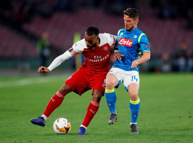 Arsenal's Alexandre Lacazette in action with Napoli's Dries Mertens