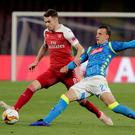 Napoli's Vlad Chiriches in action against Arsenal's Aaron Ramsey. Photo: Ciro De Luca/Reuters