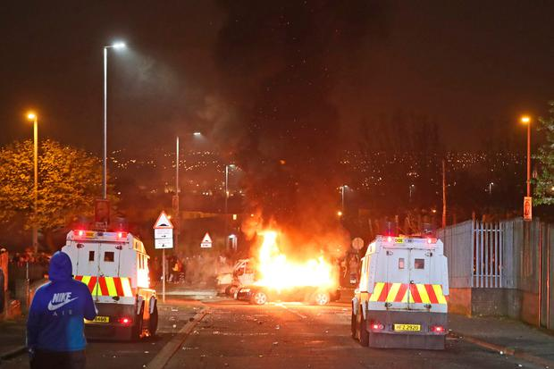 Hijacked vehicles on fire in Creggan, Derry. Photo: PA