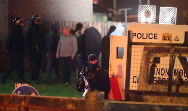 Armed police in Creggan, Derry after shots were fired and petrol bombs were thrown at police. Photo: PA
