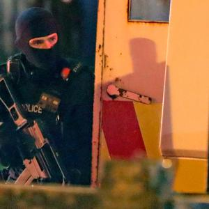 Armed police at the scene of unrest in Creggan, Derry. Photo: PA