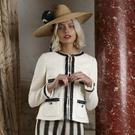 "Straw hat with silk turban made with Ciara Silke patterned scarf, €500, Anthony Peto;""Charlee"" black&white jacket, €390,L.K.Bennett, Stripped trousers,€55 at River Island"
