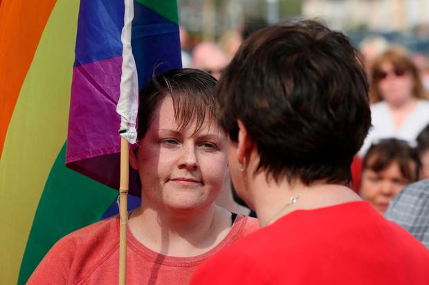 DUP leader Arlene Foster (right) speaks with Sara Canning (left), the partner of 29-year-old journalist Lyra McKee, at a vigil in Derry, following her death last night after guns were fired and petrol bombs were thrown in what police are treating as a