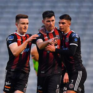 Dinny Corcoran of Bohemians, centre, is congratulated by team-mates Darragh Leahy, left, and Daniel Mandroiu after scoring his side's first goal during the SSE Airtricity League Premier Division match between Bohemians and UCD at Dalymount Park in Dublin. Photo by Seb Daly/Sportsfile