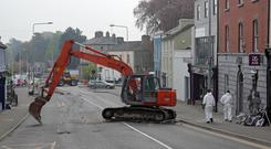 Morning theft: Gardaí at the scene of a double ATM robbery on Main Street, Kells, Co Meath. Photo: Colin Keegan, Collins