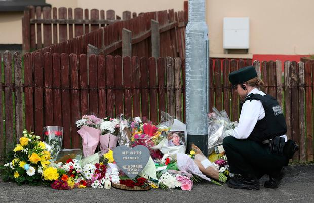Floral tributes are left. Photos: PA