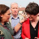 United in sorrow: Sinn Féin leader Mary Lou McDonald with DUP leader Arlene Foster at a vigil in Derry following the death of journalist Lyra McKee. Photo: Brian Lawless/PA Wire