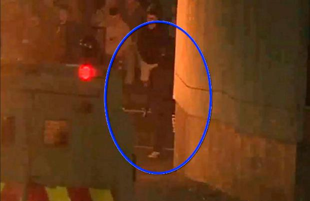 Suspect: A still from the footage released by the PSNI showing the suspect (circled)