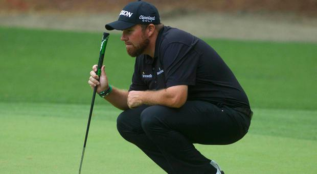 Shane Lowry holds onto the lead at RBC Heritage as stormy weather impacts day two