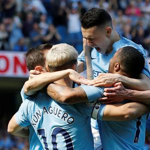 Soccer Football - Premier League - Manchester City v Tottenham Hotspur - Etihad Stadium, Manchester, Britain - April 20, 2019 Manchester City's Phil Foden celebrates scoring their first goal with team mates. REUTERS/Phil Noble
