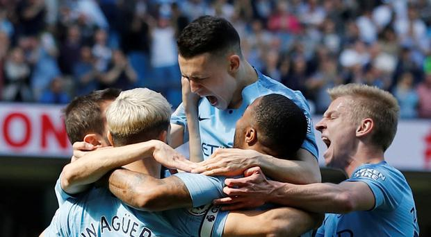Title race takes another twist as Man City squeeze past Spurs to overtake Liverpool at the top