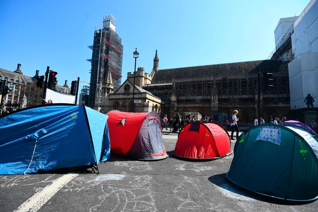 Extinction Rebellion demonstrators camp in Parliament Square in Westminster, London. Photo: Victoria Jones/PA Wire
