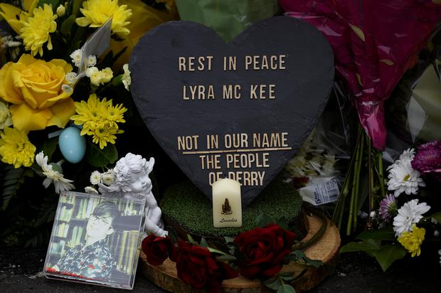 Flowers and a candle are left at the exact spot where 29-year-old journalist Lyra McKee was shot dead in Derry, Northern Ireland April 20, 2019. REUTERS/Clodagh Kilcoyne