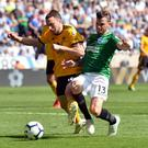 Soccer Football - Premier League - Wolverhampton Wanderers v Brighton & Hove Albion - Molineux Stadium, Wolverhampton, Britain - April 20, 2019 Brighton's Pascal Gross in action with Wolverhampton Wanderers' Diogo Jota. REUTERS/Peter Powell