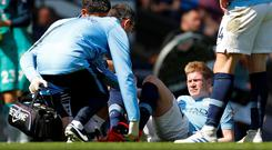 Manchester City's Kevin De Bruyne receives medical attention after sustaining an injury during yesterday's match against Spurs. Photo: Phil Noble/Reuters