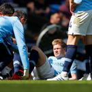 Soccer Football - Premier League - Manchester City v Tottenham Hotspur - Etihad Stadium, Manchester, Britain - April 20, 2019 Manchester City's Kevin De Bruyne receives medical attention after sustaining an injury. REUTERS/Phil Noble