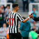 Newcastle United's Ayoze Perez celebrates with Newcastle United manager Rafael Benitez after the final whistle of the Premier League match at St James' Park, Newcastle. Richard Sellers/PA Wire.