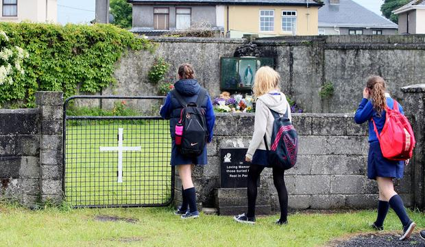 Schoolchildren visit a shrine in Tuam erected in memory of the children buried there. Photo: AFP/Getty Images