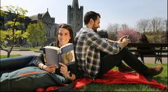 Meredith Raico and Matt McLoughlin reading The Hunchback of Notre Dame next to St Patrick's Cathedral, Dublin. Photo: David Conachy.