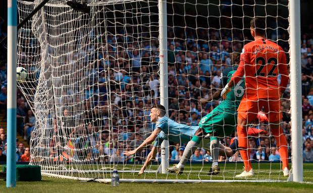 Manchester City's Phil Foden scores what proved to be the winning goal against Tottenham during yesterday's Premier League match at the Etihad Stadium. Photo: Oli Scarff/Getty