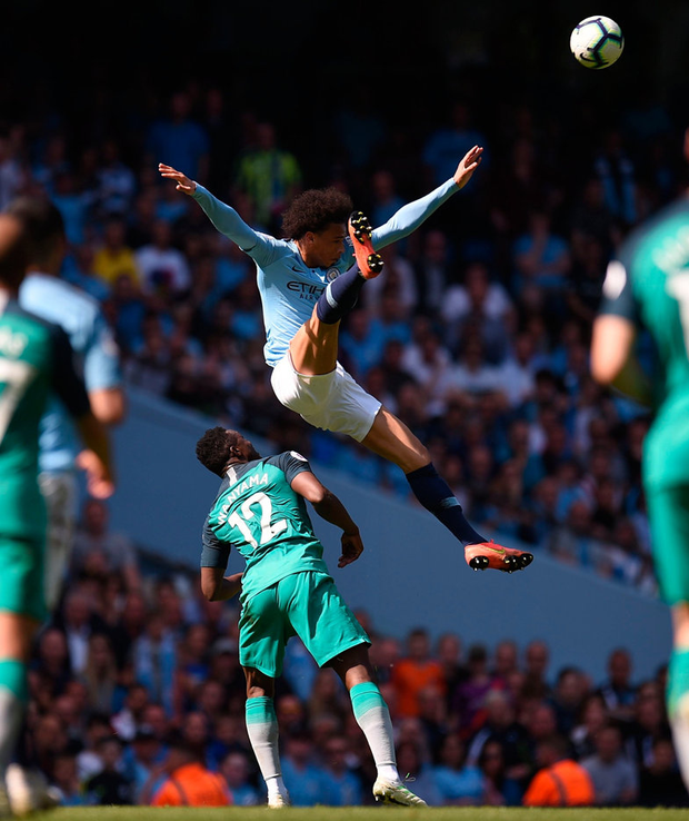 Manchester City's German midfielder Leroy Sane (R) jumps for the ball over Tottenham Hotspur's Kenyan midfielder Victor Wanyama (L). Photo: OLI SCARFF/AFP/Getty Images
