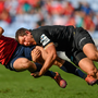 Darren Sweetnam of Munster is tackled by Alex Goode of Saracens during the Heineken Champions Cup Semi-Final match between Saracens and Munster at the Ricoh Arena in Coventry, England. Photo by Brendan Moran/Sportsfile