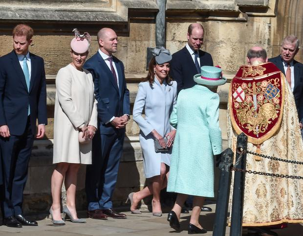 Prince Harry, Duke of Sussex, Zara Tindall, Mike Tindall, Catherine, Duchess of Cambridge and Prince William, Duke of Cambridge greet Queen Elizabeth II as she arrives to attend the Easter Mattins Service at St. George's Chapel, at Windsor Castle, Britain, April 21, 2019. Eamonn M. McCormack/Pool via REUTERS