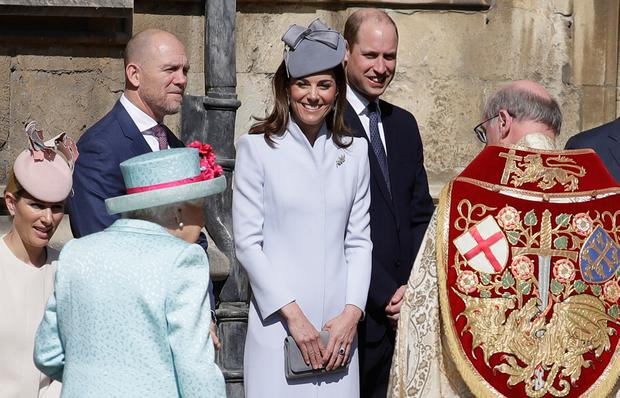 (left to right) Zara Tindall, Mike Tindall, the Duchess of Cambridge and the Duke of Cambridge greet Queen Elizabeth II as she arrives for the Easter Mattins Service at St George's Chapel, Windsor Castle, Windsor. PRESS ASSOCIATION Photo. Picture date: Sunday April 21, 2019. Photo credit should read: Kirsty Wigglesworth/PA Wire