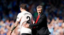 Manchester United's Victor Lindelof (left) and Manchester United Manager Ole Gunnar Solskjaer after the final whistle of the Premier League match at Goodison Park, Liverpool. Martin Rickett/PA Wire.