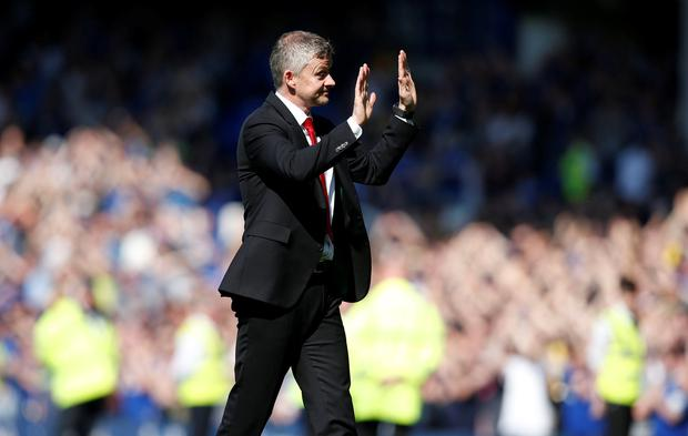 Ole Gunnar Solskjaer gestures towards the travelling fans after yesterday's defeat at Goodison. Photo: Reuters/Andrew Yates