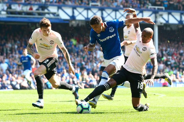 Dominic Calvert-Lewin of Everton is challenged by Ashley Young of Manchester United. Photo by Jan Kruger/Getty Images