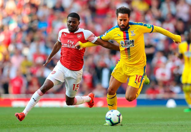 Andros Townsend of Crystal Palace holds off Ainsley Maitland-Niles of Arsenal. Photo by Warren Little/Getty Images