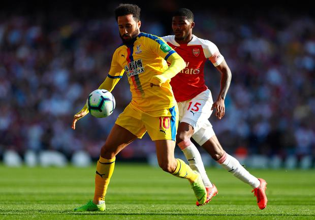 Andros Townsend of Crystal Palace holds off Ainsley Maitland-Niles of Arsenal. Photo by Clive Rose/Getty Images