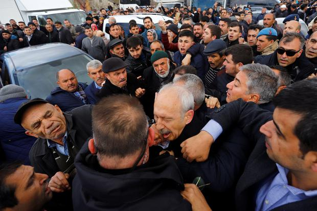 Security team surrounds main opposition party leader. Photo: Reuters