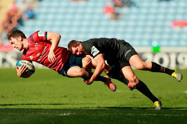 Darren Sweetnam of Munster Rugby is tackled by Alex Goode of Saracens. Photo: David Rogers/Getty Images