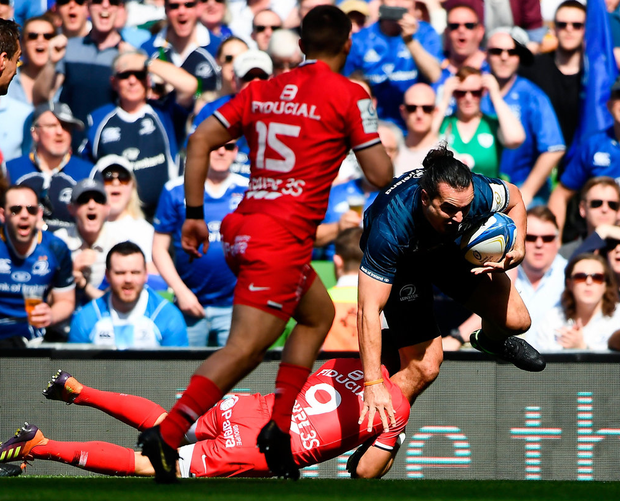 James Lowe of Leinster breaks through the tackle of Sébastien Bézy of Toulouse. Photo: David Fitzgerald/Sportsfile
