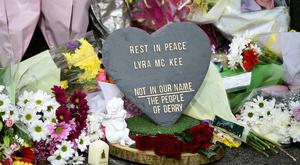 Flowers at the scene where the 29-year-old journalist Lyra McKee was shot dead. Photo: Reuters/Clodagh Kilcoyne